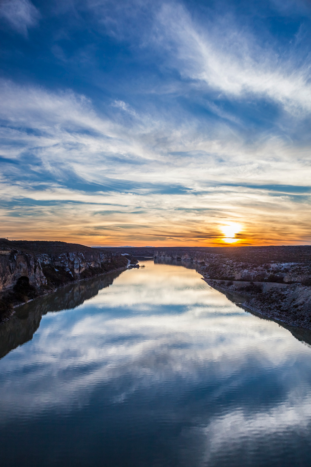 Pecos River confluence with Rio Grande River at sunset