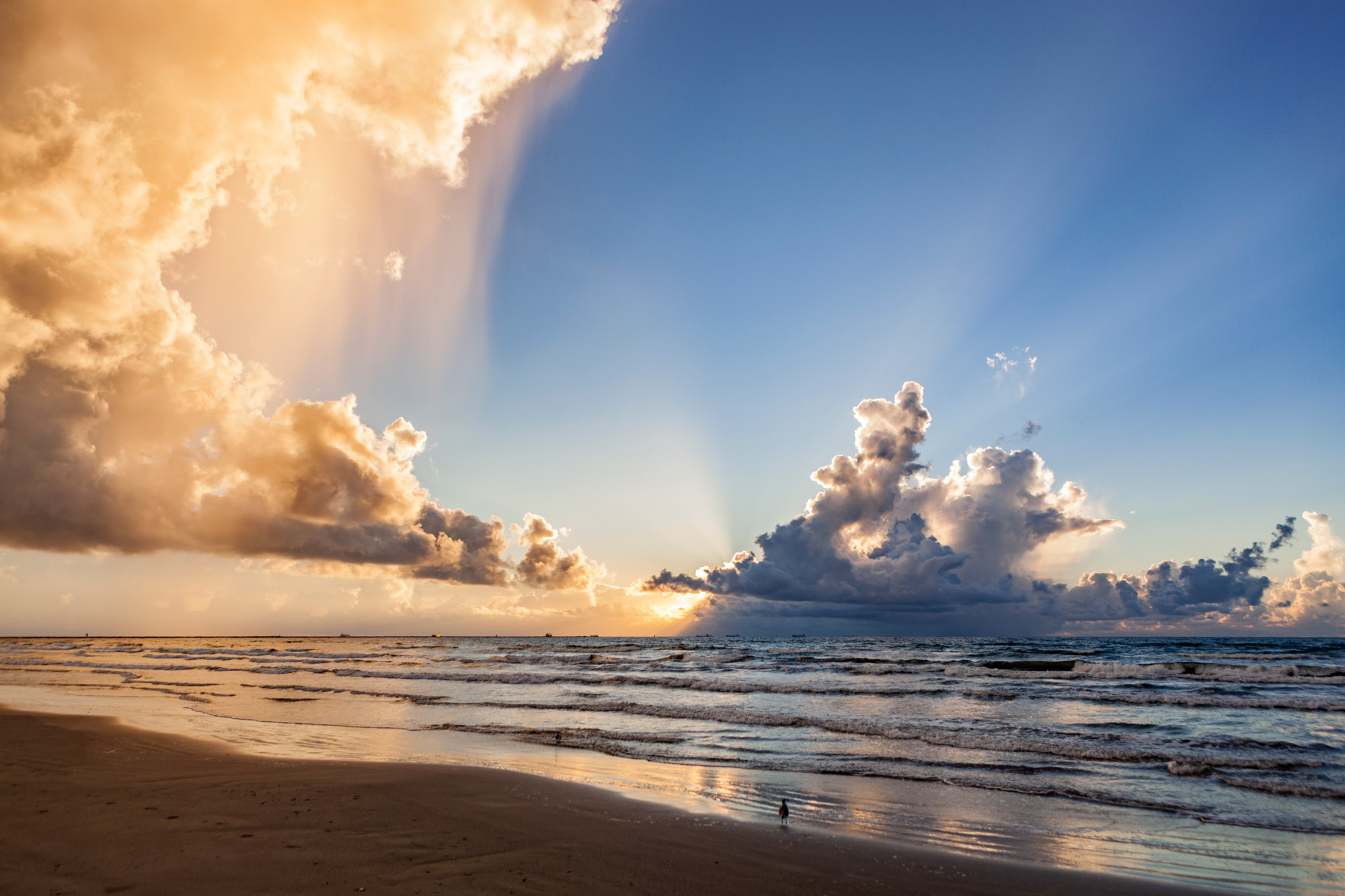 Blue sky and rain cloud at sunrise on the beach