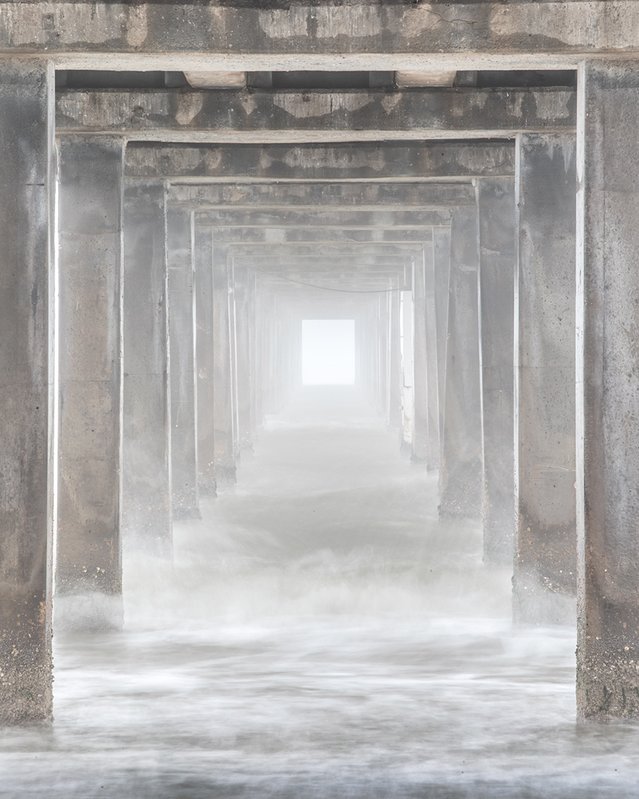 Under Horace Caldwell Pier in fog - Port Aransas
