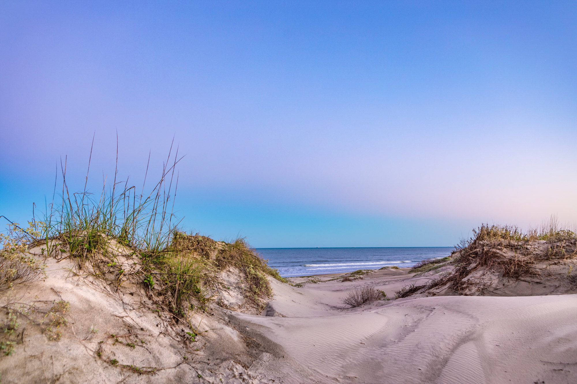 Sand dune with pink and blue sky at twilight