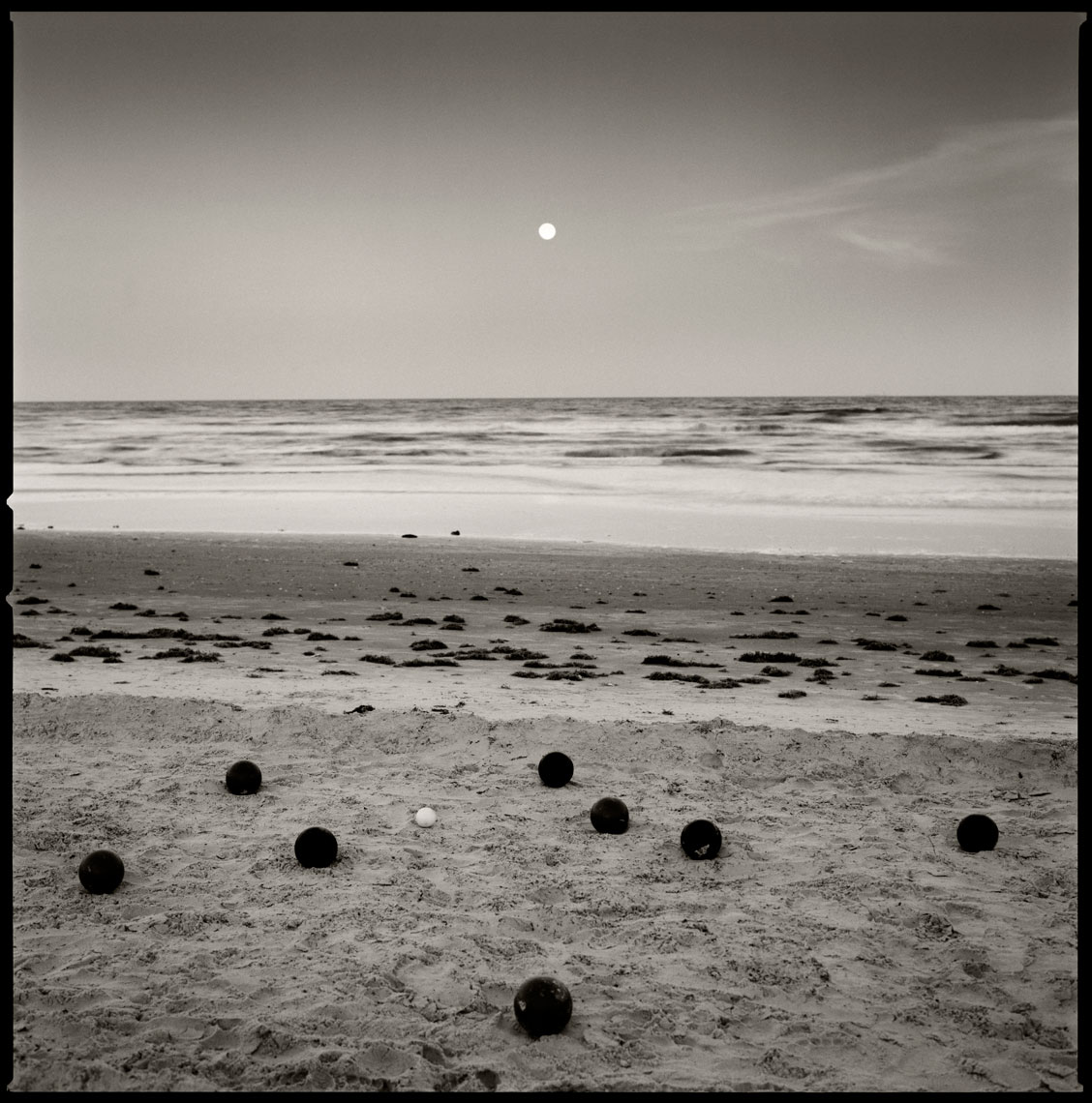 Bocce Balls on the beach with moon rise