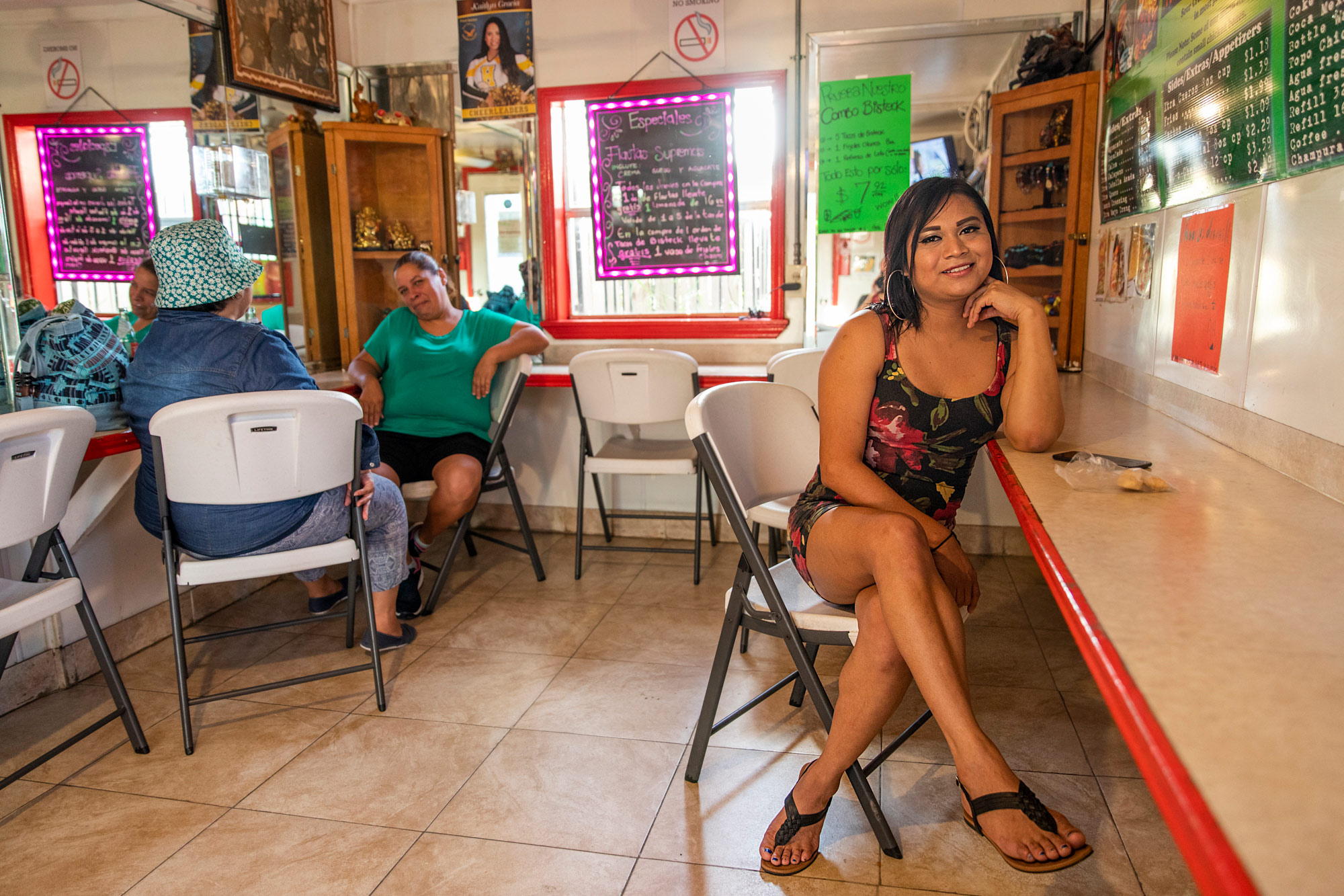 Waiting for her order at Tacos to Go in Brownsville