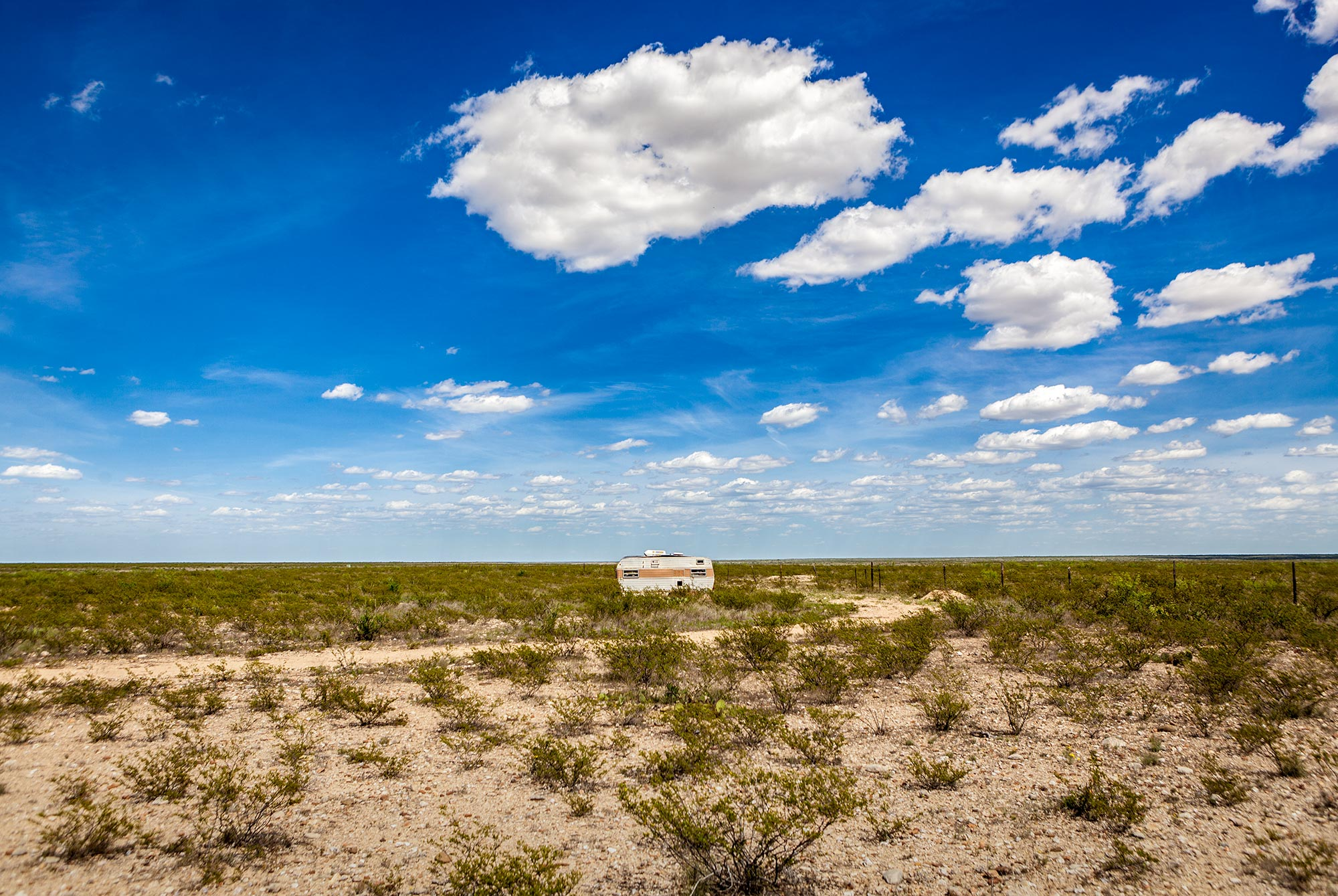 Old travel trailer in the desert - West Texas